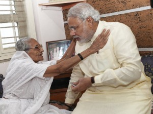 Narendra Modi seeking blessings from his mother on his birth anniversary