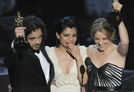 Inocente Izucar (center)with filmmakers Sean Fine and Andrea Nix Fine at Oscars Ceremony on 24th Feb.2013