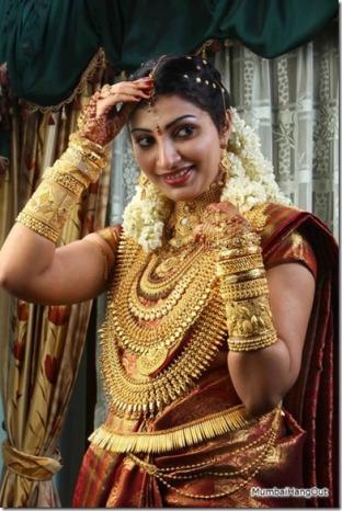 Gold laden bride