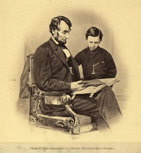 President Abraham Lincoln reading  to his son, Tad, 1864 - Photo Courtesy Library of Congress