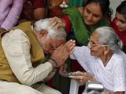 Modi, the 63-year-old son of a tea seller seeks blessings of his 90+ year old Mother Hiraben .