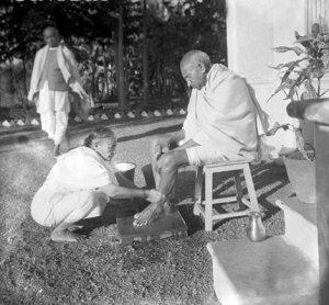 Kasturba is seen washing feet of her husband Gandhiji . Sardar Patel  is also seen looking at this memorable scene of love between this great couple !