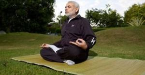 """ Yoga synchronises the mind,body and soul."" ---Narendra Modi"