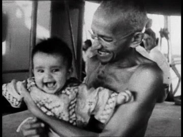 Father of the Nation laughing with a laughing child